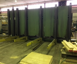 Destacking-stacking line for sawn timber packs
